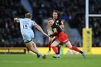 Chris Ashton of Saracens eyes up his options as Chris Pennell of Worcester Warriors challenges during the Premiership Rugby match between Saracens and Worcester Warriors - 28/11/2015 - Twickenham Stadium, London<br /> Mandatory Credit: Rob Munro/Stewart Communications