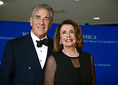 United States House Minority Leader Nancy Pelosi (Democrat of California), right, and her husband, Paul, left, arrive for the 2018 White House Correspondents Association Annual Dinner at the Washington Hilton Hotel on Saturday, April 28, 2018.<br /> Credit: Ron Sachs / CNP<br /> <br /> (RESTRICTION: NO New York or New Jersey Newspapers or newspapers within a 75 mile radius of New York City)