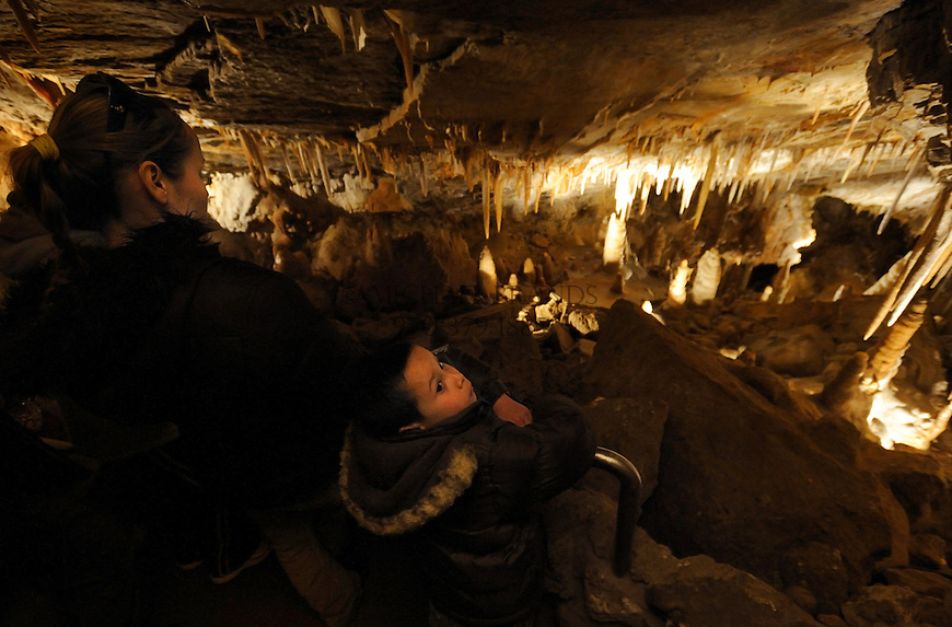 Luis Quintero Jr., 7, looks at stalactites on the ceiling of Kings Row in the Glenwood Caverns. Michael Brands for The New York Times.