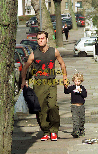 JUDE LAW & SON RAFFERTY .Out Shopping.father and son, family, paparazzi picture, full length, full-length, walking, vest, red shoes, holding hands.www.capitalpictures.com.sales@capitalpictures.com.© Capital Pictures