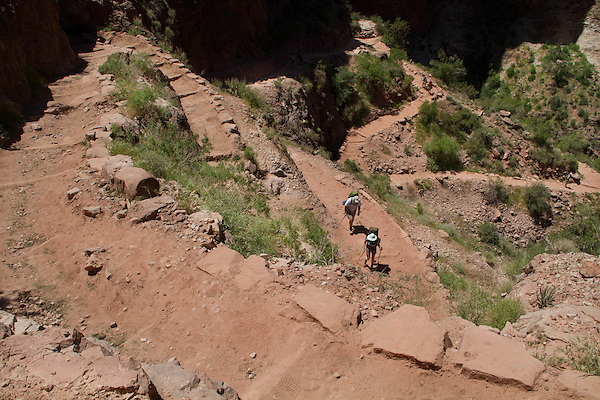 Backpackers on the Bright Angel Trail above Indian Gardens, Grand Canyon National Park, Arizona .  John leads hiking and photo tours throughout Colorado. . John offers private photo tours in Grand Canyon National Park and throughout Arizona, Utah and Colorado. Year-round.