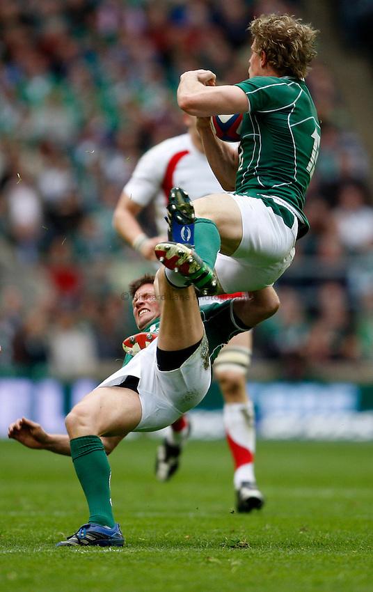 Photo: Richard Lane/Richard Lane Photography. .England v Ireland. RBS Six Nations. 15/03/2008. Ireland's Andrew Trimble and Ronan O'Gara collide as they go up for a high ball.