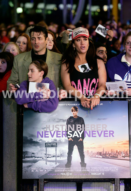 **ALL ROUND PICTURES FROM SOLARPIX.COM**                                             **NO UK NEWSPAPER PUBLICATION**.**UK MAGAZINE & SUPPLEMENT PUBLICATION ONLY** AND NO PUBLICATION IN AUSTRALIA, BELGIUM, FRANCE, GERMANY, ITALY, SCANDINAVIA AND USA**                                                                                  Caption: Justin Bieber arrives at the European Premiere of Never Say Never at the 02 Arena on February 13, 2011 in London, England.                                                                              This pic: Fans                                                                                             JOB REF:12814        SFE       DATE: 16.02.2011                                                           **MUST CREDIT SOLARPIX.COM OR DOUBLE FEE WILL BE CHARGED**                                                                      **MUST AGREE FEE BEFORE ONLINE USAGE**                               **CALL US ON: +34 952 811 768 or LOW RATE FROM UK 0844 617 7637**