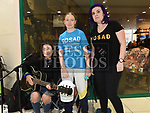 Jessica Donagh busking for SOSAD with Arleene Heeney and Karen Dullaghan in the Lauresce Centre. Photo:Colin Bell/pressphotos.ie