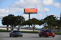 "WEST PALM BEACH, FL - JANUARY 07: A sign with the words ""GOP"" and the ""O"" fashioned in the shape of a hammer and sickle topped by a star, which mimics the former Soviet Union's flag, is seen along the route that President Donald Trump drives through on his way from the airport to his home Mar-A-Lago when he is visiting Florida, The sign was installed by The Mad Dog PAC on January 7, 2019 in West Palm Beach Florida.  <br /> CAP/MPI04<br /> ©MPI04/Capital Pictures"