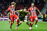 Rodrigo Battaglia of Sporting CP (C) fights for the ball with Antoine Griezmann of Atletico de Madrid (L) and Juan Francisco Torres Belen, Juanfran, of Atletico de Madrid (R) during the UEFA Europa League quarter final leg one match between Atletico Madrid and Sporting CP at Wanda Metropolitano on April 5, 2018 in Madrid, Spain. Photo by Diego Souto / Power Sport Images