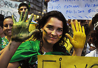 A demonstrator shows the hands painted with brazilian flag colours during a manifestation  on the streets of Rio to protest against official corruption and spending on next year's World Cup, Rio de Janeiro, Brasil, June 20, 2013.  (Austral Foto/Renzo Gostoli)