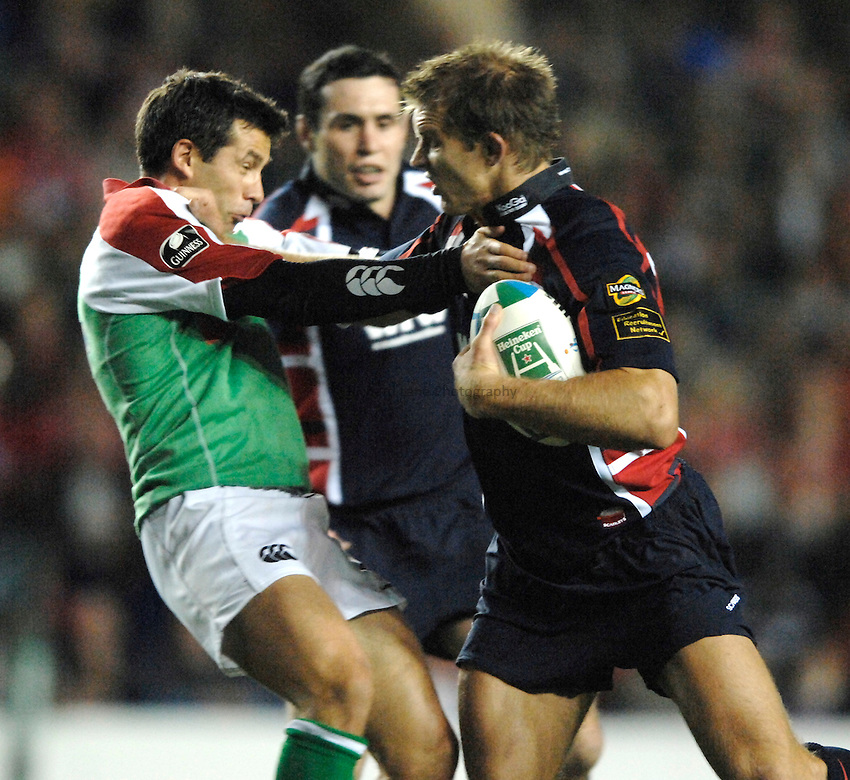 Photo: Richard Lane..London Irish v Llanelli Scarlets. Heineken Cup. 20/10/2006. .Llanelli's Daffyd James hands off Barry Everitt of Irish.