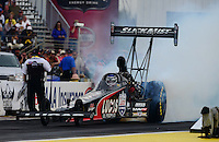 Sept. 28, 2012; Madison, IL, USA: NHRA top fuel dragster driver Bruce Litton during qualifying for the Midwest Nationals at Gateway Motorsports Park. Mandatory Credit: Mark J. Rebilas-