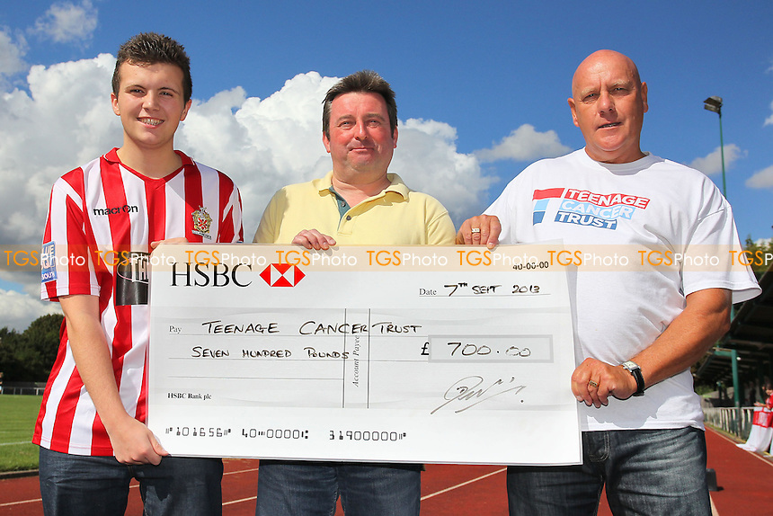 Jordan Newman (L), Dave Seddon (C) and Colin Burford of the AFC Hornchurch Supporters Association with a cheque for £700 for the Teenage Cancer Trust - AFC Hornchurch vs East Thurrock United - Ryman League Premier Division Football on Non-League Day at The Stadium, Upminster Bridge, Essex - 07/09/13 - MANDATORY CREDIT: Gavin Ellis/TGSPHOTO - Self billing applies where appropriate - 0845 094 6026 - contact@tgsphoto.co.uk - NO UNPAID USE