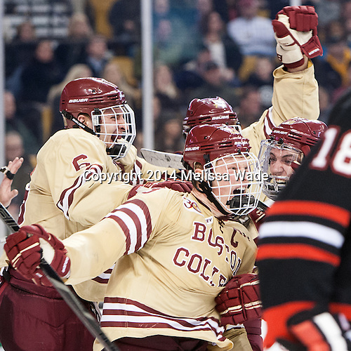 Steven Santini (BC - 6), Patrick Brown (BC - 23) and Ryan Fitzgerald (BC - 19) celebrate Brown's goal. - The Boston College Eagles defeated the Northeastern University Huskies 4-1 (EN) on Monday, February 10, 2014, in the 2014 Beanpot Championship game at TD Garden in Boston, Massachusetts.