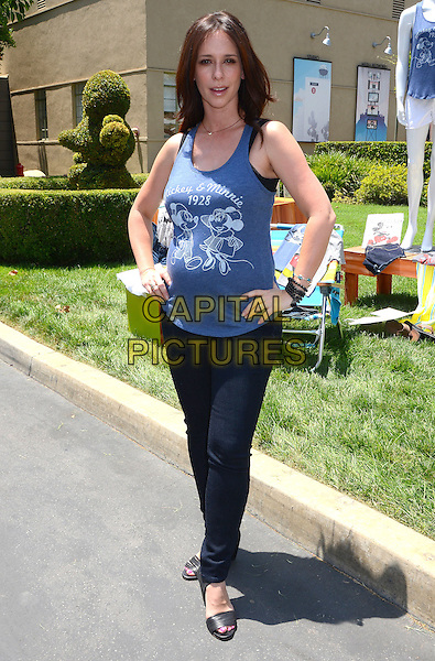 Jennifer Love Hewitt<br /> Old Navy Launches &quot;Mickey Through the Decades&quot; Vintage Tee Collection at Walt Disney Studio Lot in Burbank, CA, USA,<br /> 13th July 2013.<br /> full length blue vest top jeans pregnant hands on hips mickey minnie mouse <br /> CAP/ADM/BT<br /> &copy;Birdie Thompson/AdMedia/Capital Pictures