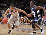SIOUX FALLS, SD - MARCH 5:  George Marshall #11 of South Dakota State drives past Obe Emegano #15 of Oral Roberts in the 2016 Summit League Tournament.  (Photo by Dick Carlson/Inertia)