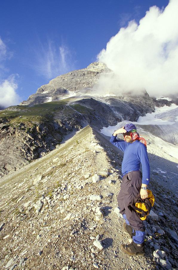 Climber on moraine below Mount Sir Donald, Glacier National Park, British Columbia, Canada