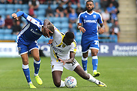 Burton Albion's Lucas Akins loses his footing and tries to drag Gillingham's Stuart O'Keefe to the ground during Gillingham vs Burton Albion, Sky Bet EFL League 1 Football at The Medway Priestfield Stadium on 10th August 2019