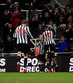 9th December 2017, St James Park, Newcastle upon Tyne, England; EPL Premier League football, Newcastle United versus Leicester City; Joselu of Newcastle United is mobbed by Matt Ritchie and DeAndre Yedlin of Newcastle United after scoring in the 4th minute to make it 1-0