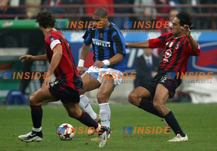 Milano 24/10/2004 Campionato Italiano Serie A 7a giornata - Matchday 7 - Milan Inter<br /> Adriano Inter (C) between Paolo Maldini Milan (L) and Alessandro Nesta Milan (R)<br /> Photo Insidefoto