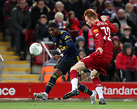 30th October 2019; Anfield, Liverpool, Merseyside, England; English Football League Cup, Carabao Cup, Liverpool versus Arsenal; Ainsley Maitland-Niles of Arsenal crosses the ball into the Liverpool penalty area as Sepp van den Berg of Liverpool attempts to challenge - Strictly Editorial Use Only. No use with unauthorized audio, video, data, fixture lists, club/league logos or 'live' services. Online in-match use limited to 120 images, no video emulation. No use in betting, games or single club/league/player publications