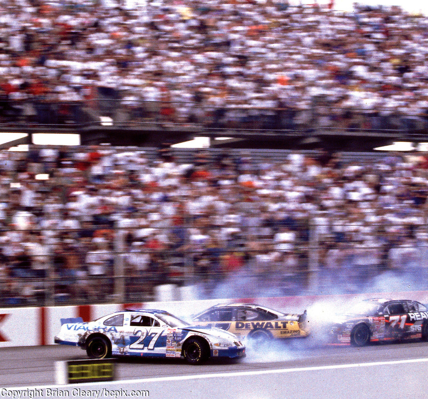 Mike Bliss(#27) , Matt Kenseth and Dave Marcis (#71) crash on the frontstretch at Darlington, SC during the Pepsi Southern 500 NASCAR race on Sunday, 9/3/00.(Photo by Brian Cleary)  (Photo by Brian Cleary/www.bcpix.com)
