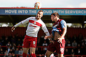 Marcus Haber of Stevenage and Niall Canavan of Scunthorpe contest a header.  Stevenage v Scunthorpe United - npower League 1 -  Lamex Stadium, Stevenage - 6th October, 2012. © Kevin Coleman 2012