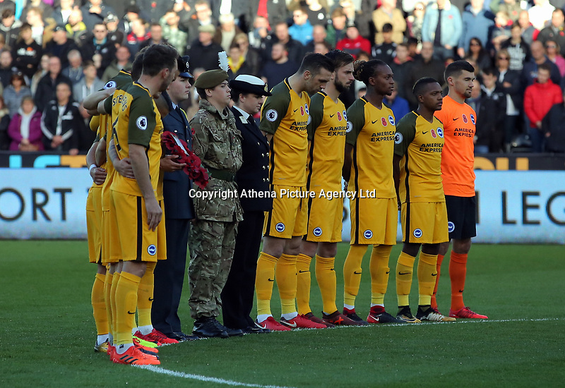 Brighton players observe a minute's silence during the Premier League match between Swansea City and Brighton and Hove Albion at The Liberty Stadium, Swansea, Wales, UK. Saturday 04 November 2017