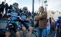 With farmers protests along the course, the race itself is delayed by 15 minutes, so riders take a break before the start is given. Like Guillaume Van Keirsbulck (BEL/Ettix-Quickstep) &amp; Nikolas Maes (BEL/Ettix-QuickStep) chatting with minister of sports Philippe Muyters<br /> <br /> 99th Ronde van Vlaanderen 2015