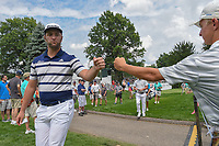 Jon Rahm (ESP) fist bumps a young fan as he heads to 16 during 1st round of the World Golf Championships - Bridgestone Invitational, at the Firestone Country Club, Akron, Ohio. 8/2/2018.<br /> Picture: Golffile | Ken Murray<br /> <br /> <br /> All photo usage must carry mandatory copyright credit (&copy; Golffile | Ken Murray)