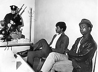 Black Panthers Bobby Seale and Bobby Hutton detained at the Oakland Police station while officers check their guns. (1967 photo by Ron Riesterer)   @copyright 2014