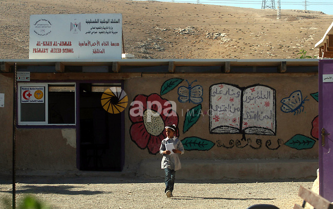 """A Palestinian student walks at her school during the visit of Palestinian Prime Minister Salam Fayyad to the """"al-Khan al-Ahmar"""" school, on the first day of the new school year, in Abu Hindi valley in the bedouin, in occupied West Bank near Jericho, on September 2, 2012. Photo by Issam Rimawi"""