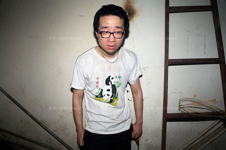 The drummer for the Wuhan, China based rock band Ten Bottles Heart, poses for a portrait in a back room at Castle Bar in Nanjing, China.