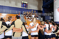 13 November 2010:  FIU's team gathers on the court near the band after the match for the playing of the FIU alma mater.  The FIU Golden Panthers defeated the South Alabama Jaguars, 3-0 (25-12, 25-12, 25-20), at U.S Century Bank Arena in Miami, Florida.