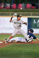 Dayton Dragons second baseman Avain Rachal (7) attempts to turn a double play as Grant Fink (33) slides in during a game against the Lake County Captains on June 7, 2014 at Classic Park in Eastlake, Ohio.  Lake County defeated Dayton 4-3.  (Mike Janes/Four Seam Images)