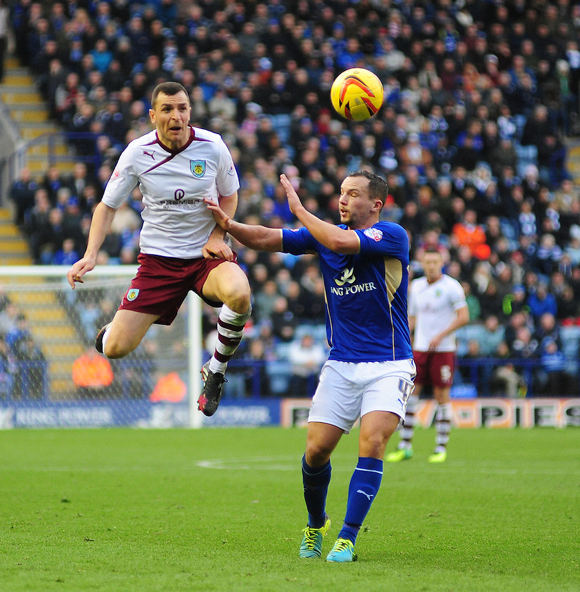 Burnley's Dean Marney vies for possession with Leicester City's Daniel Drinkwater <br /> <br /> Photo by Chris Vaughan/CameraSport<br /> <br /> Football - The Football League Sky Bet Championship - Leicester City v Burnley - Saturday 14th December 2013 - King Power Stadium - Leicester<br /> <br /> &copy; CameraSport - 43 Linden Ave. Countesthorpe. Leicester. England. LE8 5PG - Tel: +44 (0) 116 277 4147 - admin@camerasport.com - www.camerasport.com