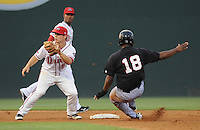 Kannapolis Intimidators third baseman Juan Silverio (18) is safe stealing second as the throw is late to second baseman Sean Coyle (5) of the Greenville Drive on Spartanburg Night, Wednesday, May 25, 2011, at Fluor Field at the West End in Greenville, S.C. Photo by Tom Priddy / Four Seam Images