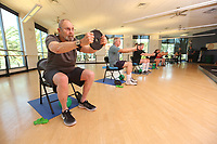 July 25, 2018. Carlsbad CA. USA. | Exercise class at Tri-City Wellness Center.