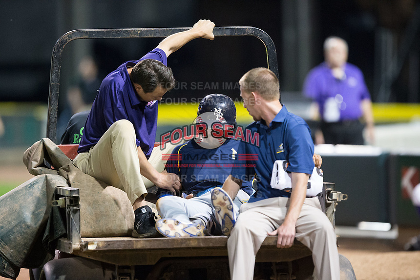 Connor Myers (9) of the Myrtle Beach Pelicans is carted off the field along with trainer Toby Williams (right) and Winston-Salem Dash President Geoff Lassiter after injuring his ankle on a play at first base during the game against the Winston-Salem Dash at BB&T Ballpark on May 11, 2017 in Winston-Salem, North Carolina.  The Pelicans defeated the Dash 9-7.  (Brian Westerholt/Four Seam Images)