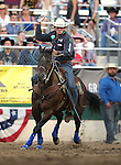 Allen Bach competes in the team roping event at the Reno Rodeo in Reno, Nev. on Friday, June 19, 2015.<br /> Photo by Cathleen Allison/Nevada Photo Source