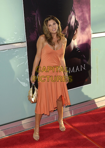 Daisy Fuentes  .Warner Brothers' World Premiere of Catwoman held at The Arclight Cinerama Dome Theatre in Hollywood, California on July 19,2004..full length orange dress gold broach bag strappy shoes.Ref: DVS.www.capitalpictures.com.sales@capitalpictures.com.©Capital Pictures.