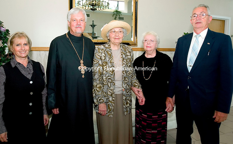 WATERTOWN, CT-27 AUGUST 2006-082706JS07-Charlotte Woodill, Fr. Joseph Woodill, Elizabeth Pishtry of Waterbury, Marion Charkowski of Watertown and church president Arthur Charkowsky at the St. Mary's Orthodox Church's 100th anniversary dinner at the Grand Oak Villa in Watertown. -Jim Shannon Republican-American