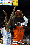 20 February 2016: Miami's Sheldon McClellan (10) and North Carolina's Isaiah Hicks (4). The University of North Carolina Tar Heels hosted the University of Miami Hurricanes at the Dean E. Smith Center in Chapel Hill, North Carolina in a 2015-16 NCAA Division I Men's Basketball game. UNC won the game 96-71.
