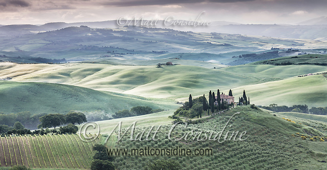 Exemplar of of an Italian Villa surrounded by cypress pines and fields. (Photo by Travel Photographer Matt Considine)