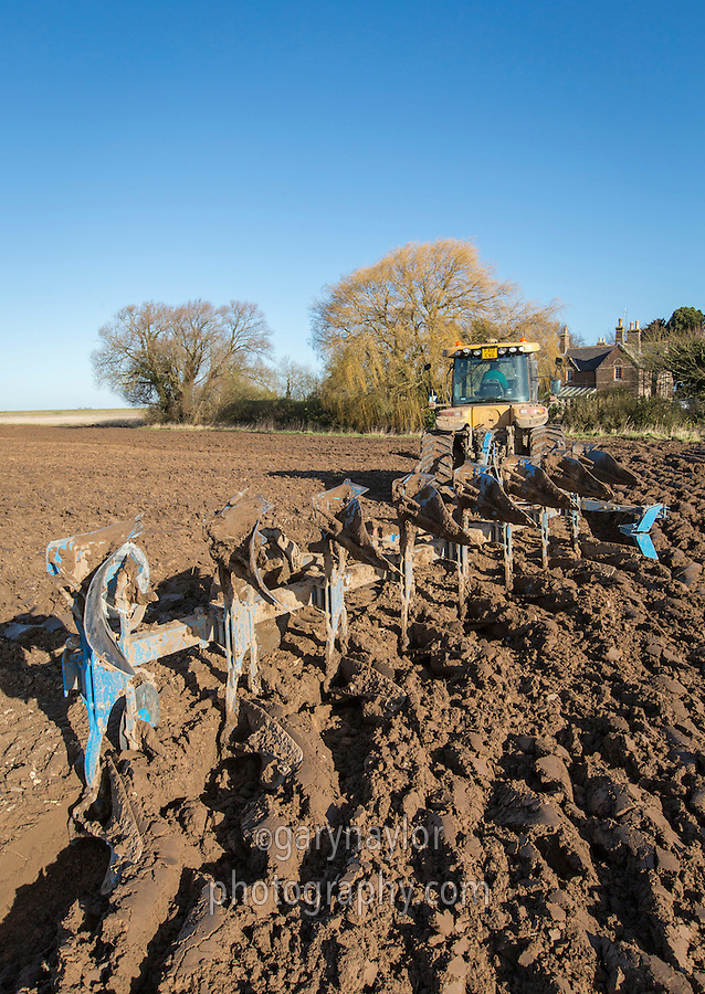 Spring ploughing with 8 furrow Lemken semi mounted plough - Lincolnshire, February