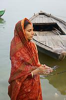 India - womens prayer at river Ganges - Varanasi