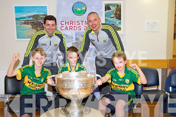 Kerry Hospice Foundation launch the 2014 Christmas card Collection at the Palliative care unit  on Monday with the help of the Sam Maguire. Pictured Front left to right, Cormac Lynch, Jack Lynch and Cillian Lynch Back l-r  Kerry Stars Aidan O'Mahony and Kieran Donaghy