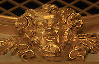 "Detail of gilded theatre mask at the bottom of the grated boxes (loges grillées) located at the Gods or Paradise (paradis or poulailler in French), upper balcony, Theatre Imperial Napoleon III de Fontainebleau (Fontainebleau Theatre Napoleon III), 1853-1856, by Hector Lefuel, Fontainebleau, Seine-et-Marne, France. Restoration of the theatre began in Spring 2013 thanks to an agreement between the Emirate of Abu Dhabi and the French Governement dedicating 5 M€ to the restoration.  In recognition of the sponsorship by the Emirate of Abu Dhabi, French Governement decided to rename the theatre as ""Theatre Cheikh Khalifa bin Zayed Al Nahyan"" (Cheikh Khalifa bin Zayed Al Nahyan Theatre). The achievement of the first stage of renovation has allowed the opening of the theatre to the public on May 3, 2014. Picture by Manuel Cohen"