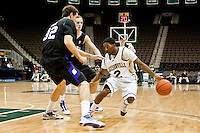 January 14, 2010:     Jacksonville guard Russell Powell (2) tries to dribble around Lipscomb center Milos Kleut (32) during Atlantic Sun conference game action between the Jacksonville Dolphins and the Lipscomb Bisons at Veterans Memorial Arena in Jacksonville, Florida.  Jacksonville defeated Lipscomb 79-73.