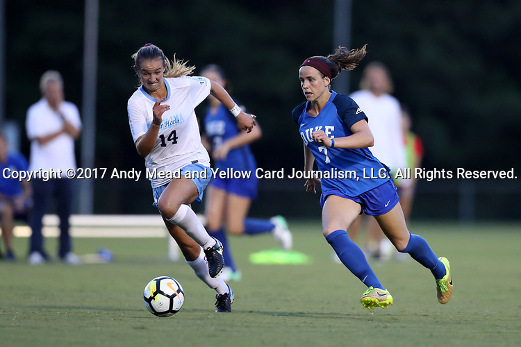 CARY, NC - AUGUST 18: Duke's Taylor Racioppi (7) and North Carolina's Morgan Goff (14). The University of North Carolina Tar Heels hosted the Duke University Blue Devils on August 18, 2017, at Koka Booth Stadium in Cary, NC in a Division I college soccer game.