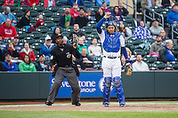 Home plate umpire A.J. Johnson and Francisco Pena (26) of the Omaha Storm Chasers in action against the Memphis Redbirds in Pacific Coast League action at Werner Park on April 24, 2015 in Papillion, Nebraska.  (Stephen Smith/Four Seam Images)