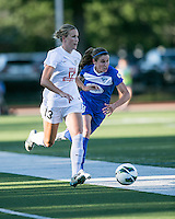 In a National Women's Soccer League Elite (NWSL) match, the Boston Breakers defeated the FC Kansas City, 1-0, at Dilboy Stadium on August 10, 2013.  FC Kansas City defender Leigh Ann Robinson (13) dribbles down the right field with Boston Breakers midfielder Heather O'Reilly (9) in pursuit.