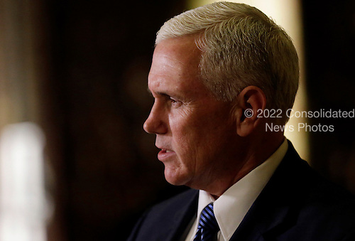 United States Vice President-elect Mike Pence speaks to reporters in the lobby of Trump Tower on November 29, 2016 in New York City. U.S. President-elect Donald Trump is still holding meetings upstairs at Trump Tower as he continues to fill in key positions in his new administration.      <br /> Credit: John Angelillo / Pool via CNP